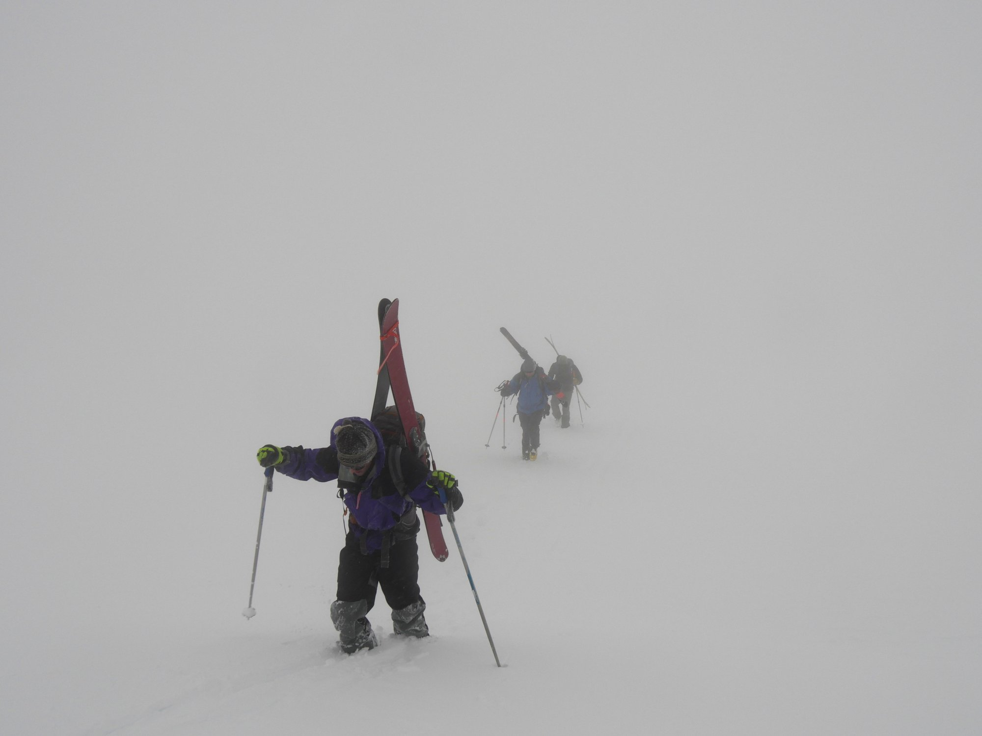 Skiers break a path along Glory ridge