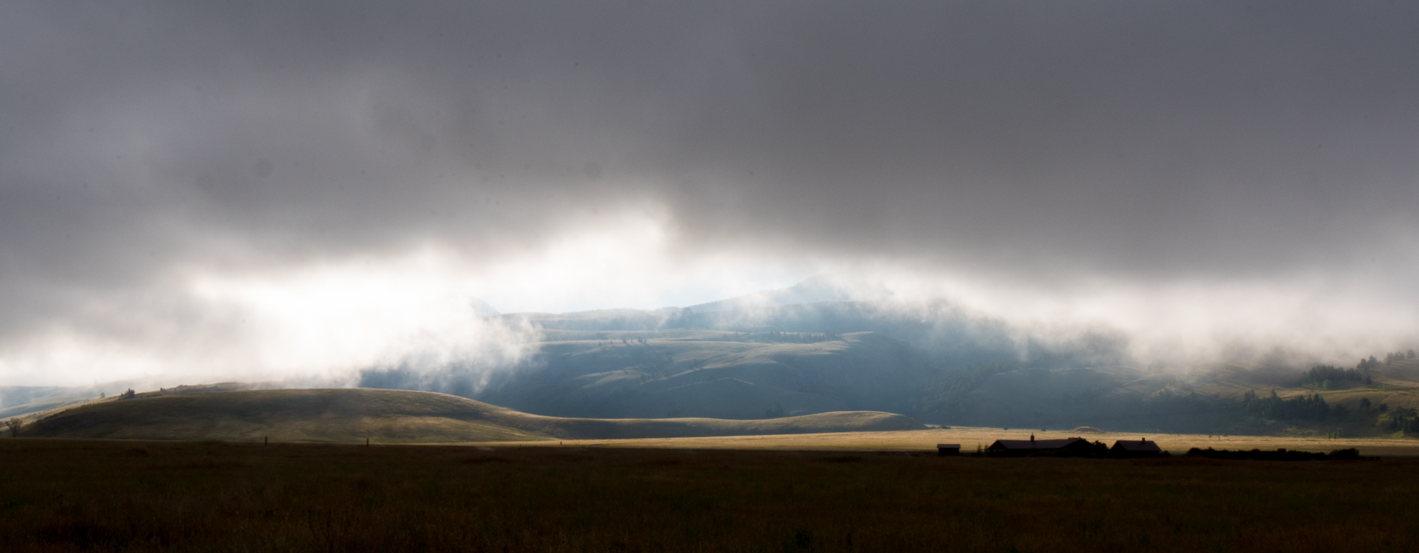 The hills at the edge of Curtis Canyon, viewed through morning fog from Elk Refuge Road